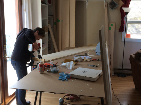 Diyer performing woodworking on wall bed parts