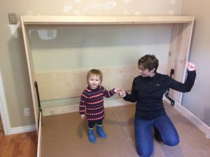 Dianne and girl on finished diy wall bed