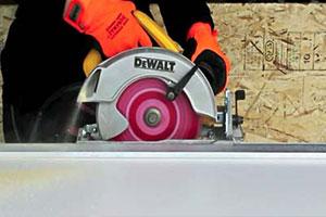 cutting wood with circular saw for DIY wall bed