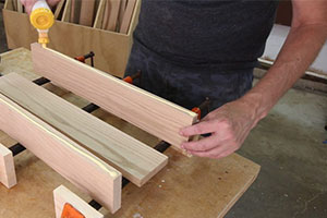 applying wood glue to Murphy bed parts